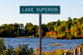 Lake superior sign post against brightly colored trees Royalty Free Stock Images