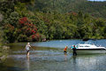 Lake tarawera new zealand crystal clear water of surrounded by pristine native bush and the christmas time bloomimg of the Stock Photography