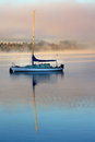 Lake te anau new zealand yacht with reflection on the on a cold misty winter morning Royalty Free Stock Photo