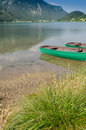 Lake in tirol with wooden boats green vertical format Royalty Free Stock Image