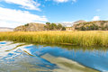 Lake titicaca south america located on border of peru and bolivia it sits m above sea level making it one of the highest Stock Photography