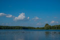Lake, trees and blue sky - summer landscape Royalty Free Stock Photo