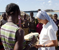 Nuns of Christian church buy handicrafts african tribe Royalty Free Stock Photo