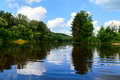 Lake View (River). On the banks of the green dense forest. Royalty Free Stock Photo