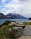 Lake wakatipu and snow capped mountains mountain view in new zealand Stock Photos