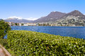 Lakefront of lugano switzerland with view over lake and mountains Royalty Free Stock Photos