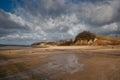 Lakeside beach and cliffs