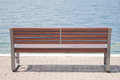 Lakeside bench on a promenade Stock Image