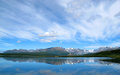 Lakeside mountain blue sky alaska Royalty Free Stock Photo