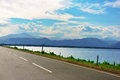 Lakeside with road nice of the udawalawe reservoir in sri lanka Royalty Free Stock Images