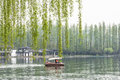 lakeside trees and boat Royalty Free Stock Photo