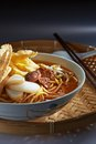 Laksa spicy noodle malaysia favorite with fish cake and cockle Stock Photo