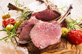Lamb chops as closeup on a wodden board Royalty Free Stock Photos
