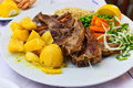Lamb chops plate dish with potatoes and vegetables served in cafe Royalty Free Stock Photo