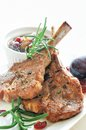 Lamb chops with prune chutney rosemary shallot and cranberry Stock Photos