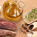 Lamb with olive oil fresh cooking ingredients Royalty Free Stock Images