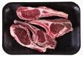 Lamb rib chops on black tray Stock Image