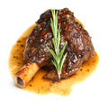 Lamb shank braised in an onion jus Royalty Free Stock Photo
