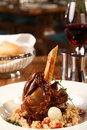 Lamb shank restaurant table with served Royalty Free Stock Photography