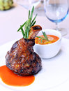 Lamb shank with sauce on a white plate Royalty Free Stock Photos