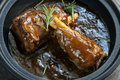 Lamb shanks in gravy with rosemary Royalty Free Stock Photography