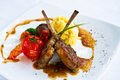 Lamb steak on white plate Stock Photos