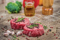 Lamb steaks. Fresh and beautiful fillet of lamb on a wooden tabl Royalty Free Stock Photo