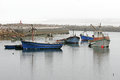 Lambertsbaai harbour western cape south africa old fishing trawlers lying at anchor in Stock Photo