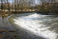 Lambro river in the monza park waterfalls of into lombardy italy at winter Royalty Free Stock Images