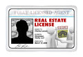 Laminated card real estate license for agent professional a identification i d or a that a buying or selling would use to prove Royalty Free Stock Image