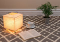 Lamp and a book to read on carpet floor Royalty Free Stock Image