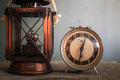Lamp and clock on table. Royalty Free Stock Photo