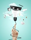 Lamp with graduation hat hand pointing to Stock Photography