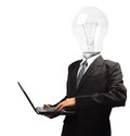 Lamp head businessman holding computer laptop pc isolated on white background objects with clipping paths for design work Royalty Free Stock Photos