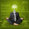 Lamp-head businessman in lotus pose Stock Photos