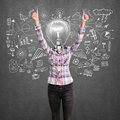 Lamp head girl with well done winning concept shows both hands Royalty Free Stock Image