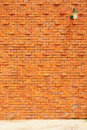 Lamp on orange brick wall background Royalty Free Stock Image