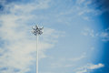 Lamp post electricity industry with blue sky background and tree
