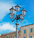 Lamp post and sky under a bright sun Royalty Free Stock Photography