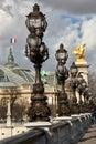 Lamp posts in paris row of on alexander lll bridge france Stock Image