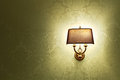 Lamp wall with a shade on the background of golden wallpaper Royalty Free Stock Photography