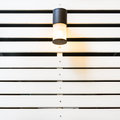 Lamp on white lath wall a Stock Photos