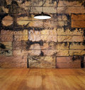 Lamp on wooden floor rotten and stain stone old brick wall background Royalty Free Stock Photo