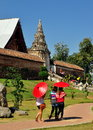 Lampang, Thailand: Women with Red Parasols Royalty Free Stock Images