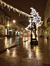 Lamplighter from lodz street polish city monument of and christmas lights lighthouse piotrowska in Stock Photos