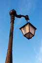 Lamppost against a blue sky Royalty Free Stock Image