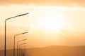 Lamppost against the sunset a sky Royalty Free Stock Photo