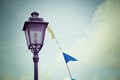 Lamppost and flags Royalty Free Stock Photo