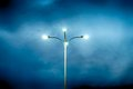 Lamppost with four lamps over background of a dramatic sky hdr image Stock Images
