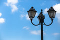 Lamppost old vintage on the blue sky background space for text Royalty Free Stock Photo